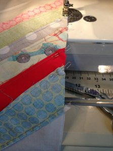 When stitching together strip sets like this, I like to use fork pins.  The old fashioned way was to put a pin on either side of a set of matching seams.  Fork pins do the same job, but with only one pin.