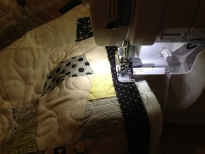 "I decided to try something new with this quilt.  Instead of using my normal sewing machine, I thought I would try to use my serger to attach the binding.  My serger has a perfect 1/4"" seam, and of course, it trims as it goes.  (I do not trim all of the excess off before I sew on the binding.)  However, the corners were very complicated.  I will probably practice this idea a little more before sharing the details of how I got it done!"