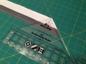 I tried to figure out how to make it work, but it just wouldn't.  You would have to continually flip the ruler to get the right cut, and that defeated the purpose of buying the ruler in the first place.  The pattern does include a template that you may use instead of the ruler, but let's be real, I am way too lazy for that.