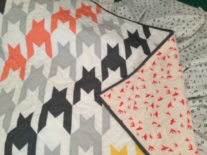 And just as I loved the backing for Baby Boy's quilt, I was just as thrilled about the backing for Baby Girl's quilt.  The birds softened the lines of the houndstooth, and the color was perfect.