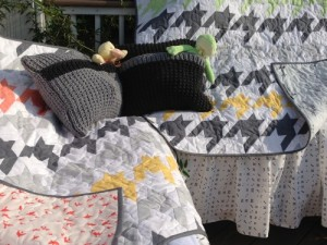 "Well, here they are- all finished and super cute!  This ""Houndstooth"" pattern by V and Co. has been so much fun to make, especially using the Quarter-Square Triangle Ruler by Creative Grids.  The color combo just about lit up my world, and I hope it does the same for those sweet babies.  Their mommy has been waiting a while for them, and deserves a lovely nursery to welcome them!"