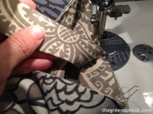 Continue sewing binding past the folded point, but stop with the needle in the down position