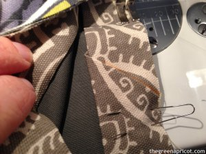 Pin binding in place and stitch to close